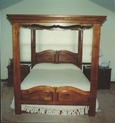 Custom-built pine canopy top bed with raised panel headboard and footboard.