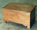 Hand-built birch blanket chest with clear lacquer finish.