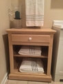 Oak towel caddy built specially for the spot shown.